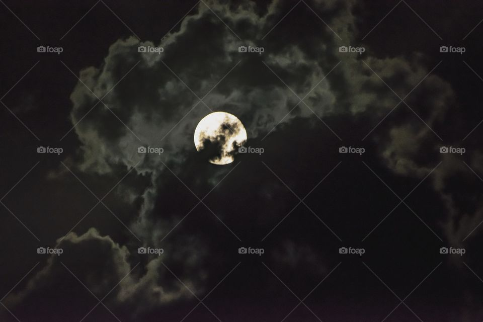 Moon in cloudy sky during night