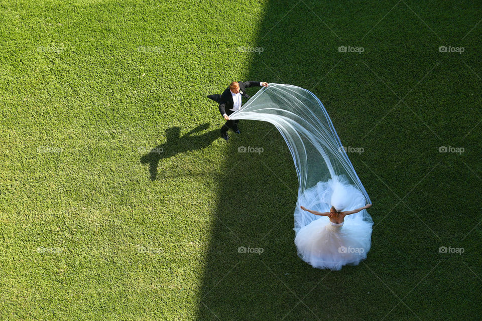 Bride and groom. Wind plays with bride's veil