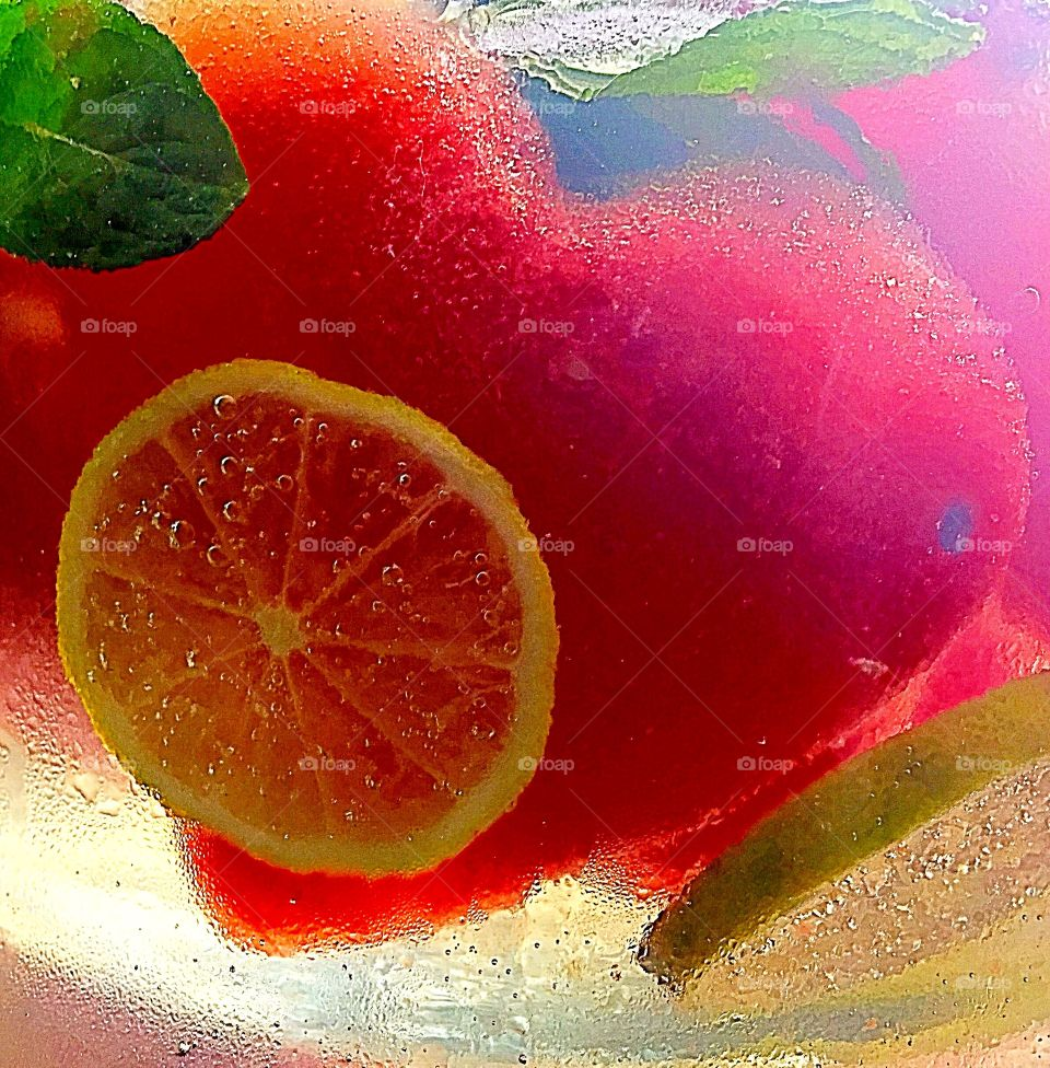 Sparkling lemonade infused with frozen heart shaped watermelon lime and fresh mint leaves