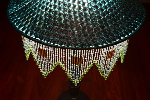 Glass beads hanging from a lampshade