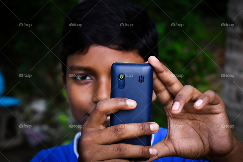 This picture is a self portrait style photography. It brings nostalgia about the phones we used to use    10 Years back , and how we used to cherish those small moments clicked with a 2 megapixel cameras , for both selfie and main pictures.