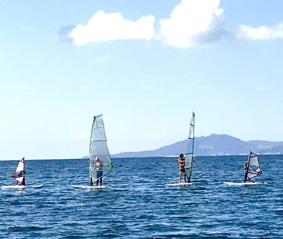 Teach them young! Lead by example, stay active so they could follow! Teaching my kids windsurfing, stay active as a whole family, enjoy water sports together and have fun together. Show them better way to spend time than playing on their mobile.
