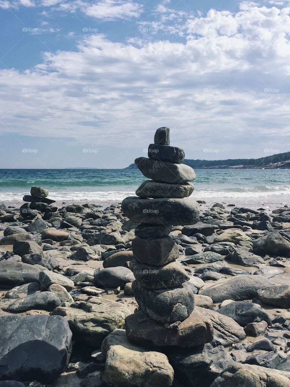 Last summer i went to sand beach in Bar Harbor, Maine, USA. And I saw people did the rocks like that. It looks so cool.  I like it so much. Also, the water is clean and fresh.