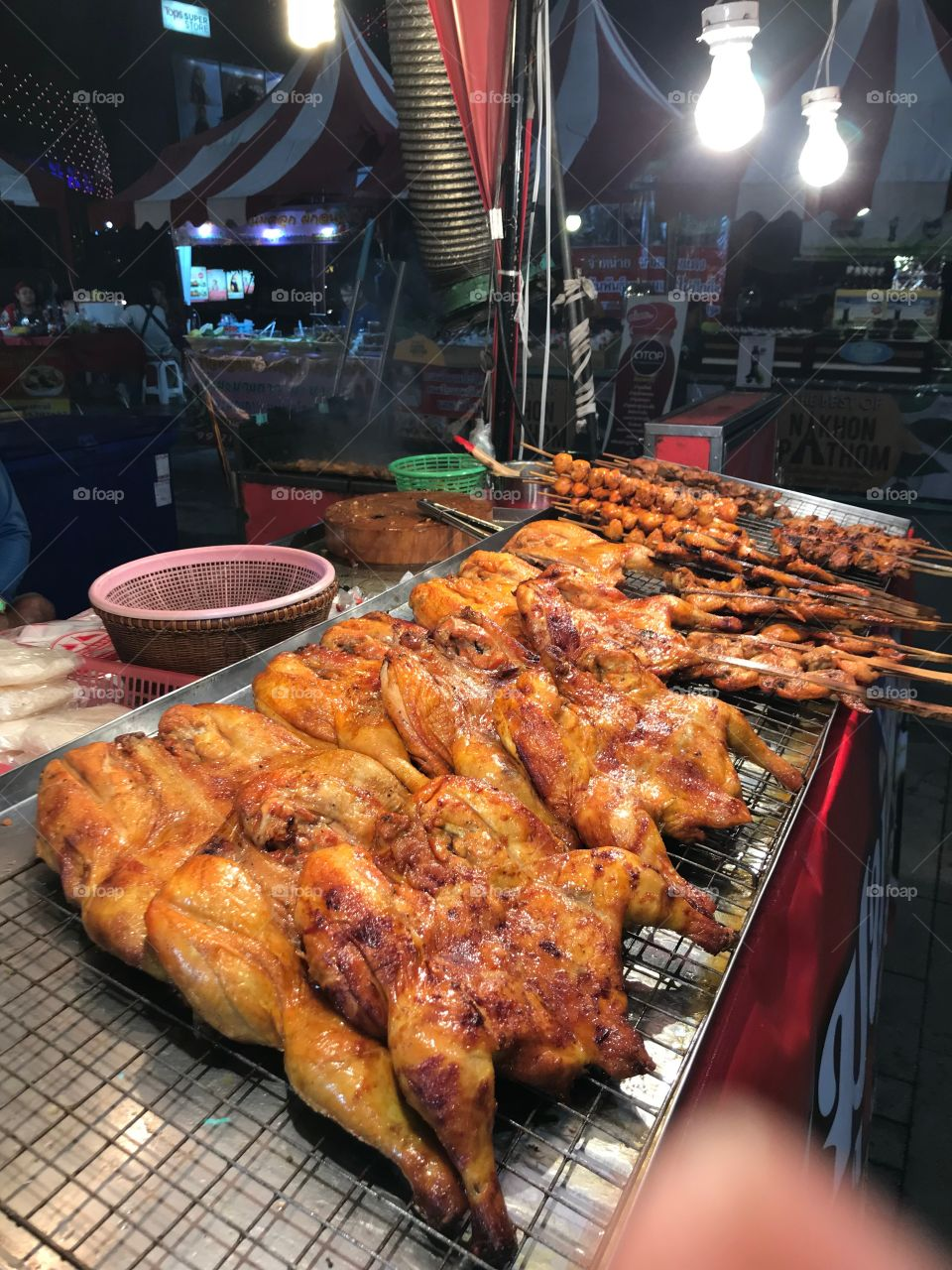 Grilled chickens in the market