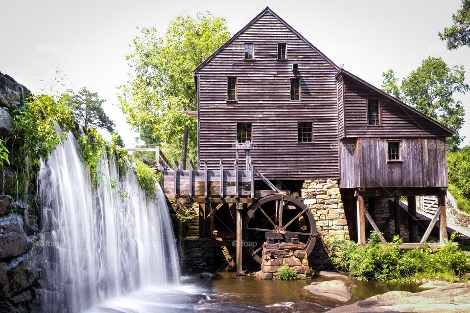 Nothing like the mill just after a summer rain, and the greenery on the waterfall just keeps on growing. Historic Yates Mill County Park in Raleigh North Carolina.