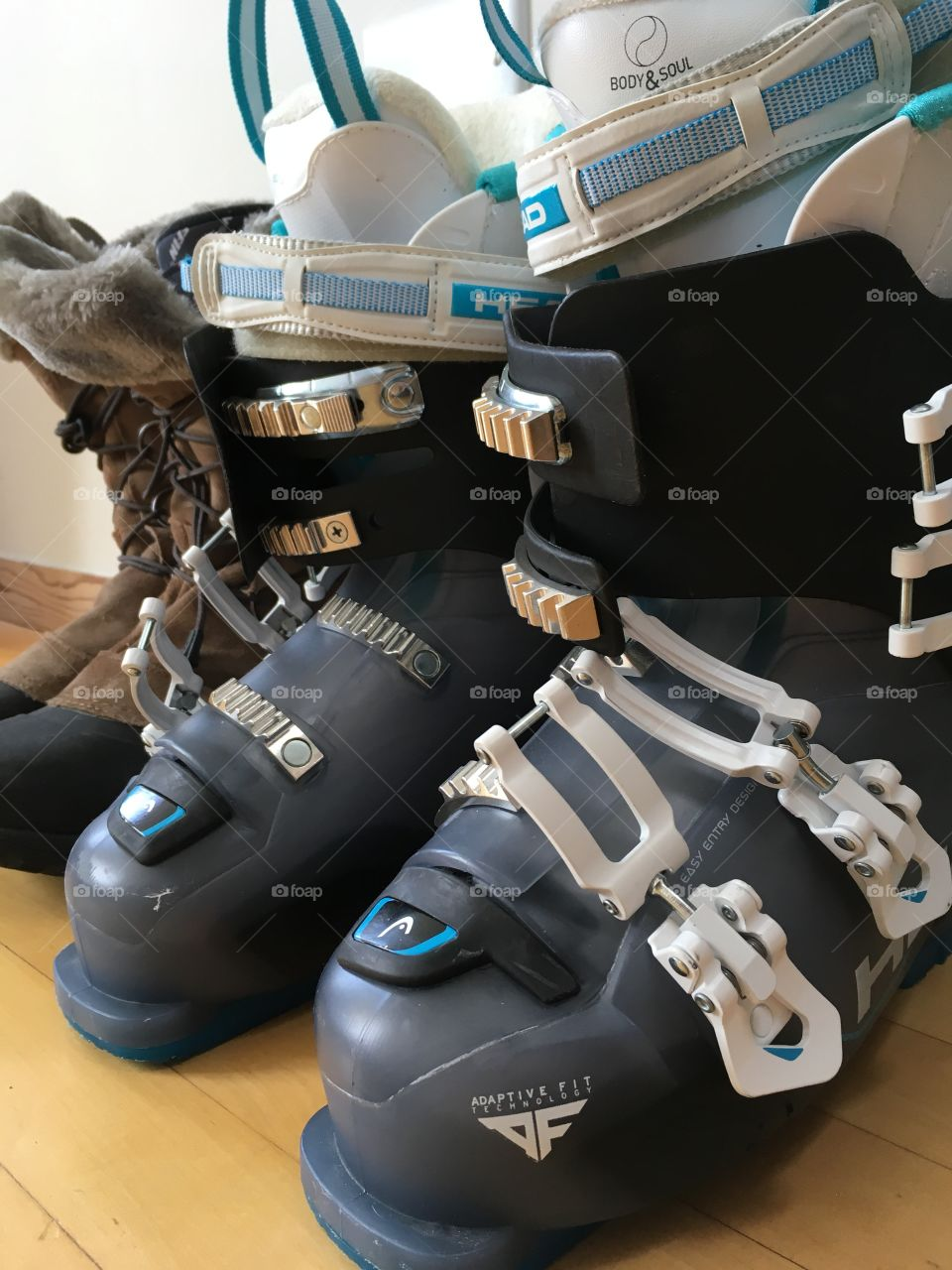 Ski boots and snow boots lined up by the door, ready for snow sport season