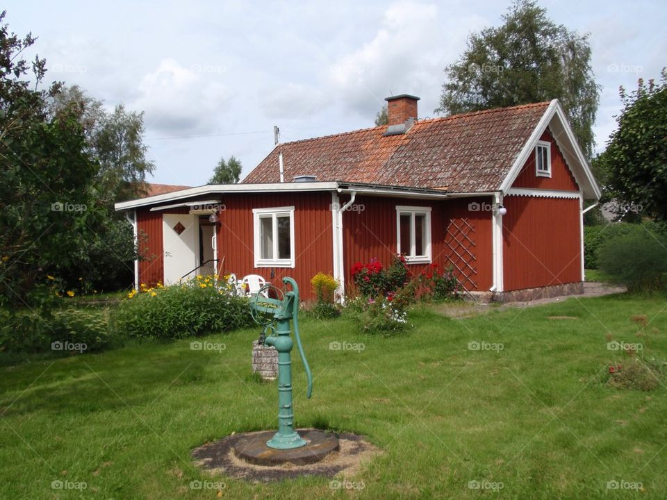 A red house with white corners.