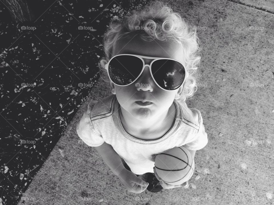 Little Boy Playing Basketball in Sunglasses