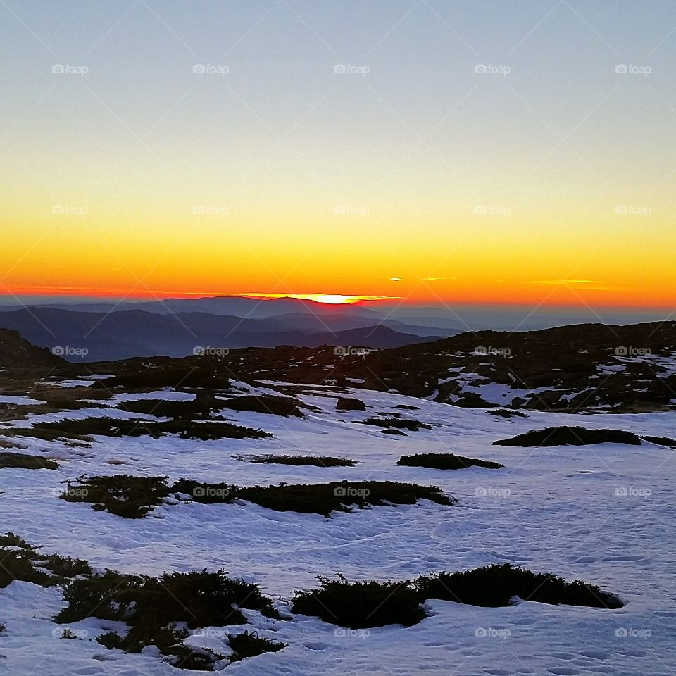 Sunset over mountain during winter