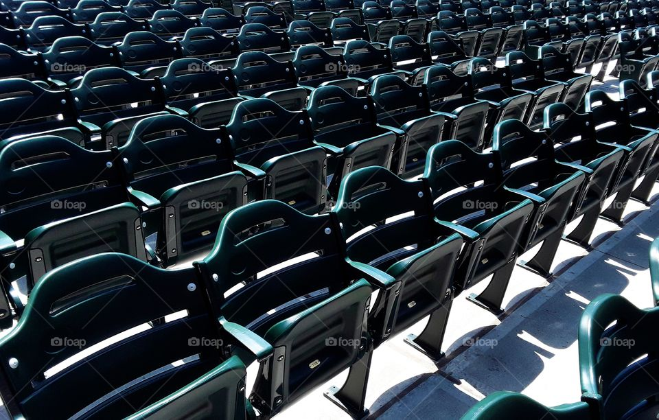 Chairs lined up in the sun