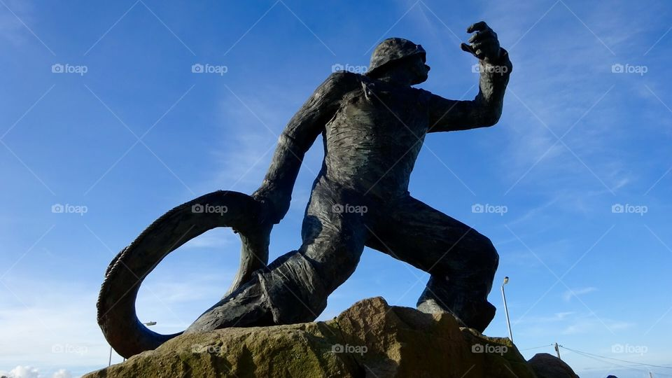 The Rescue. Statue in Seahouses Northumberland