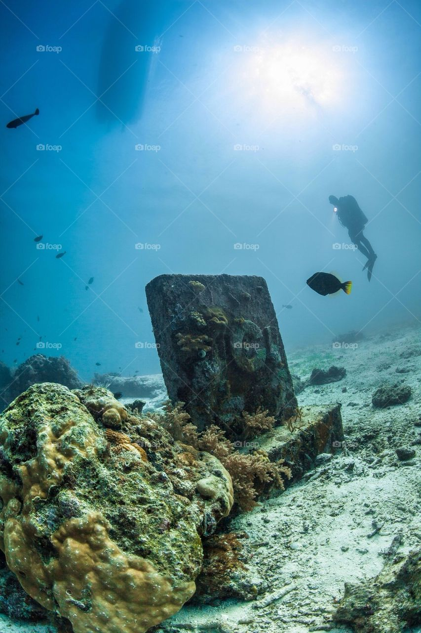 Diver and grave Stone