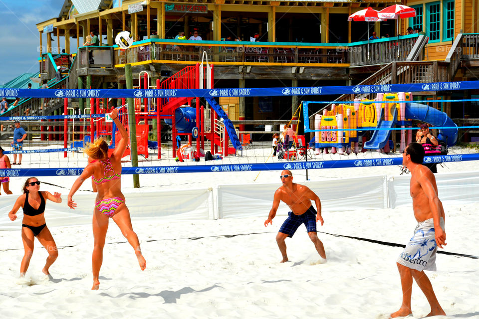 A couples team plays sand beach volley ball by the Gulf of Mexico! There was plenty of action as seen in the photo!