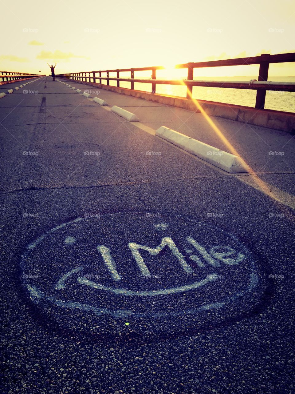 One mile . This picture was taken on the old 7 miles bridge.