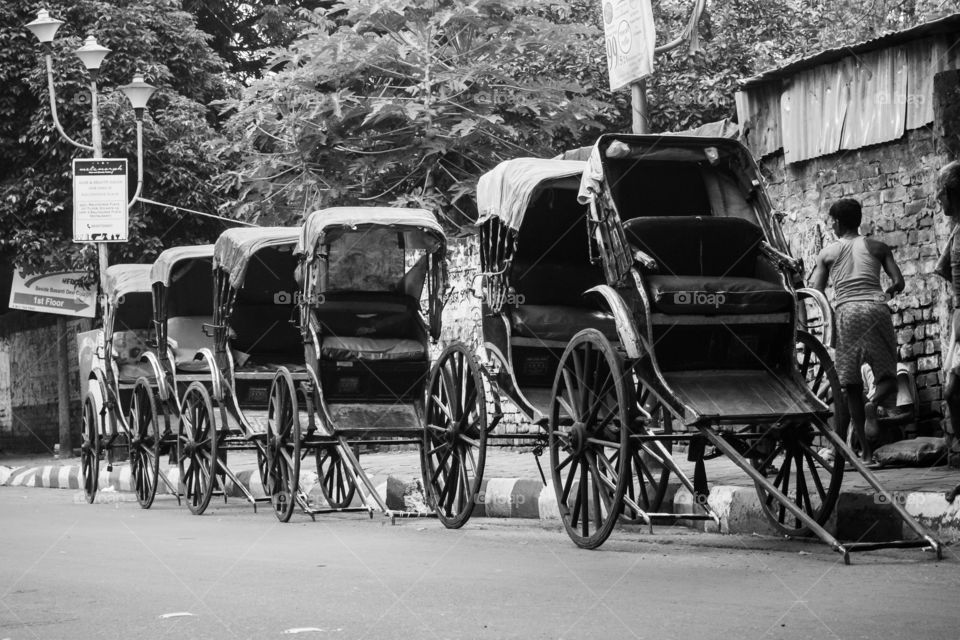 A pulled rickshaw is a mode of human-powered transport by which a runner draws a two-wheeled cart which seats one or two people.