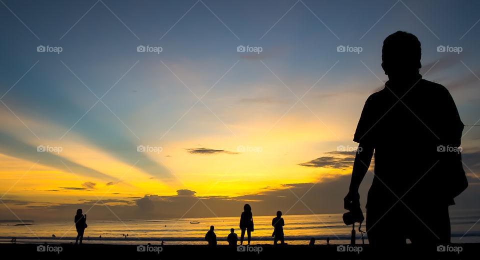 Enjoy sunset at Kuta Beach in Bali, Indonesia