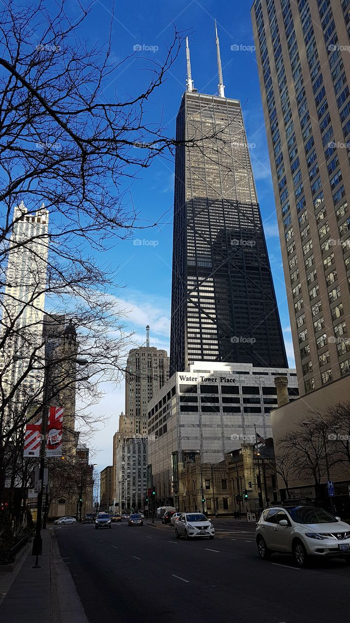 360 Chicago John Hancock Center facade in Chicago, IL, United States. External day view of the skyscraper at Water Tower Place Area.