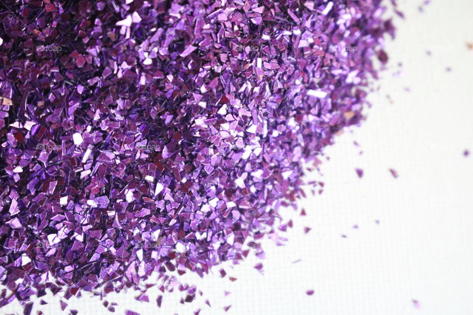 Purple glitter on white background