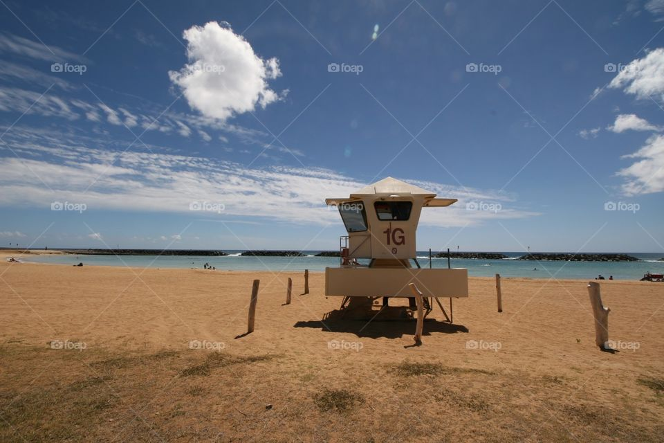 Lifeguard Tower Magic Island. A lifeguard tower on Magic Island near Waikiki. The tranquil lagoon is protected from the surf.