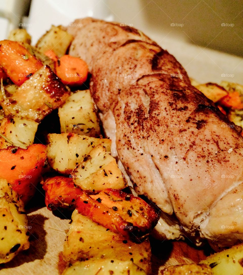 Roasted pork, carrots and potatoes