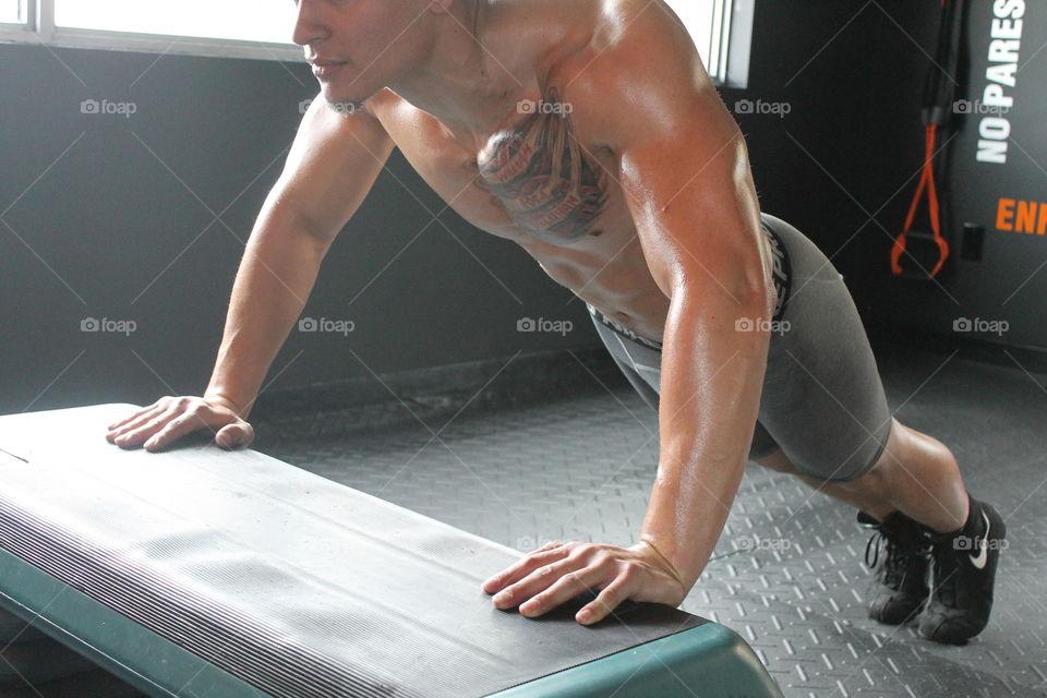 Close-up of man doing push-ups