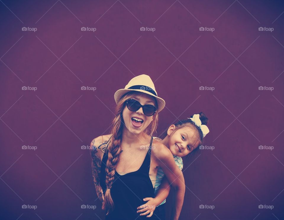 Smiling mother with her daughter