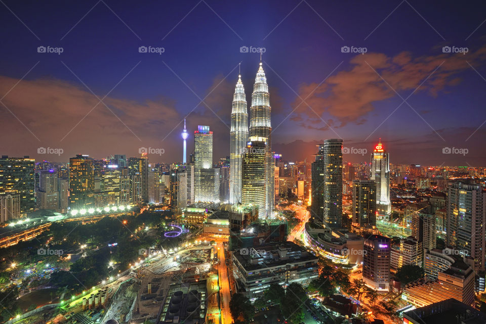 Majestic view of Kuala Lumpur city skyline during blue hour sunset