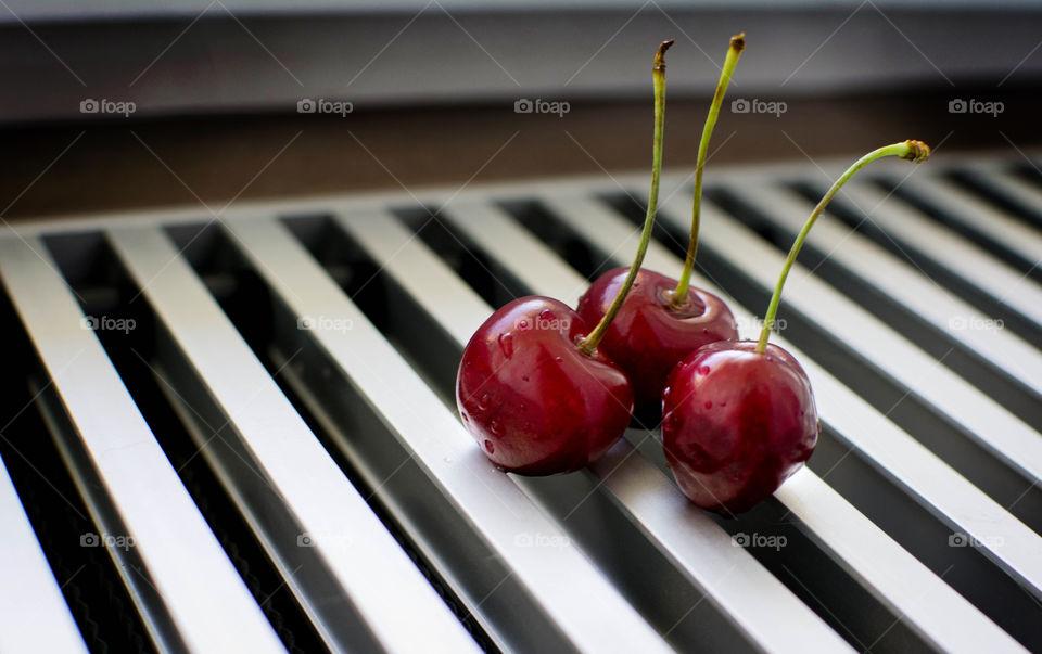 three cherries . summer berries
