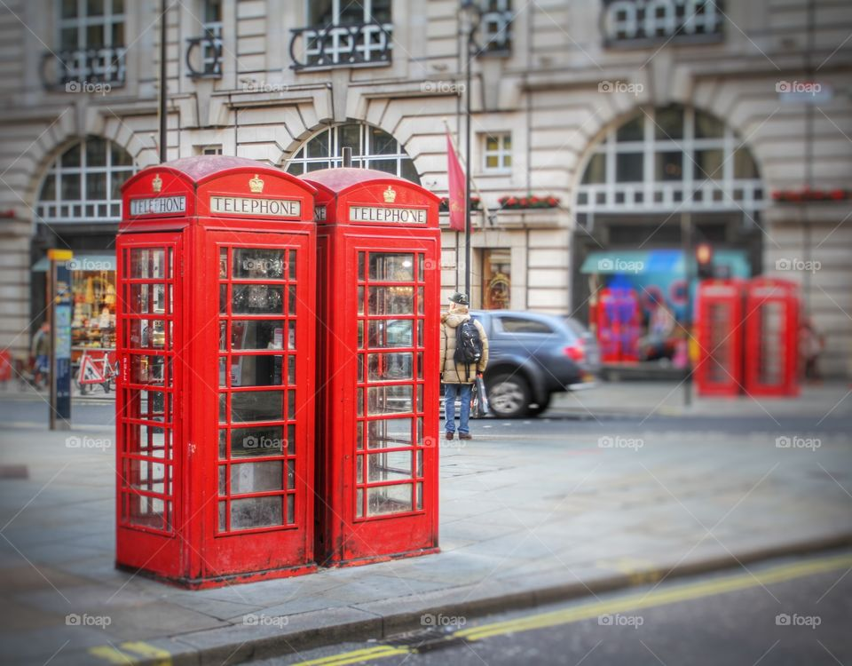 Red phone boxes on the streets of London .