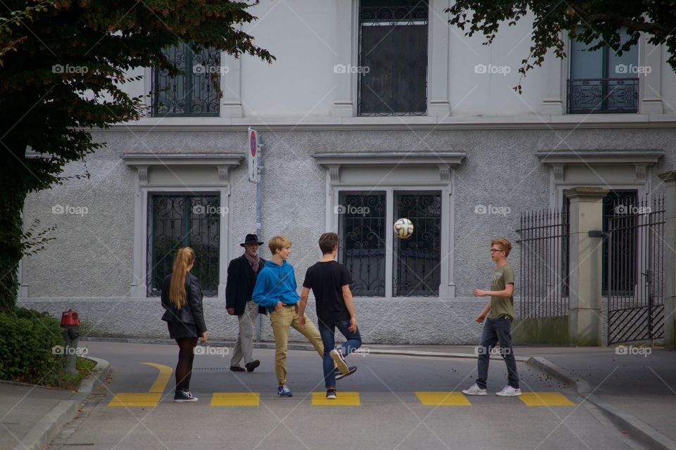 Shot Of Teenagers Playing Football In  A Street In Zürich
