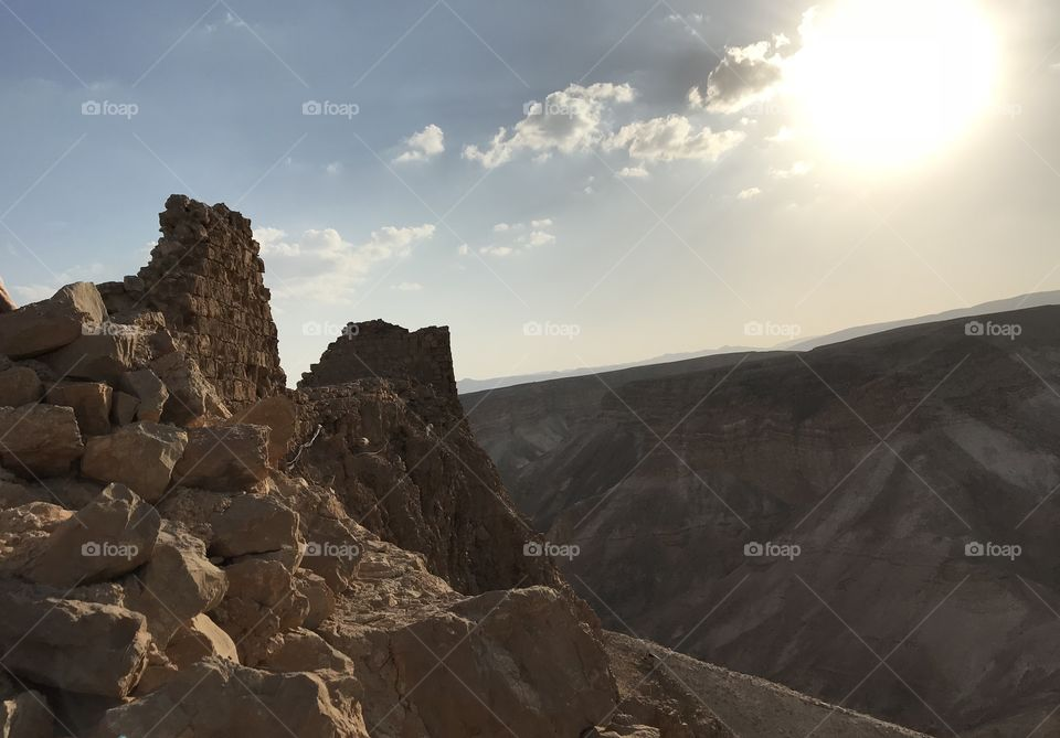 Brilliant sun over the ancient ruins of Masada, Israel, the Roman fortress that was the site of the First Jewish-Roman War in 73-74 AD.