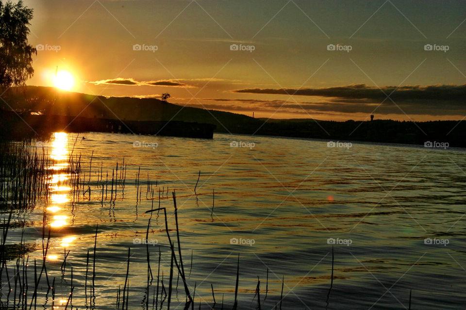 sunset orange pond water by ka71