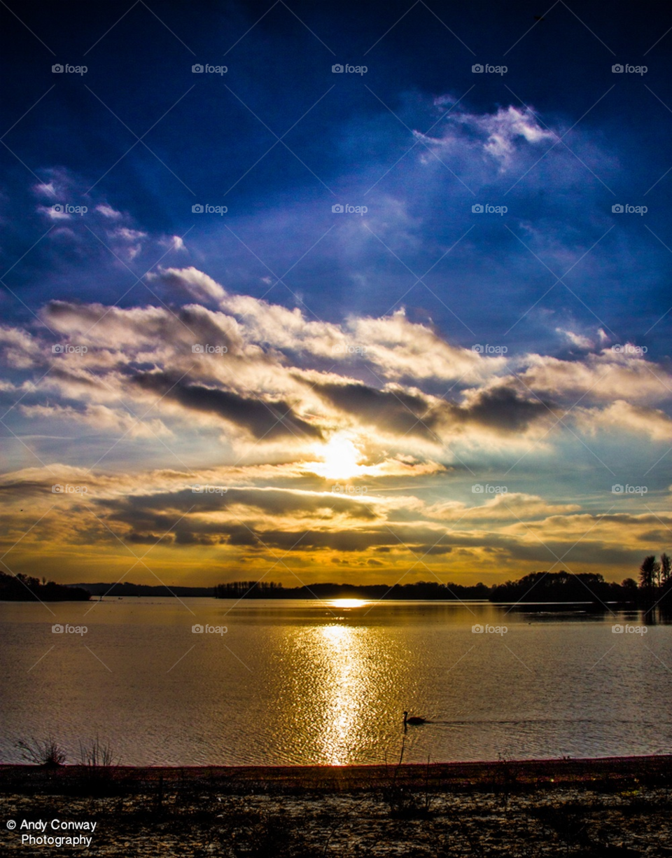 sunset lake swan surrey by andyc