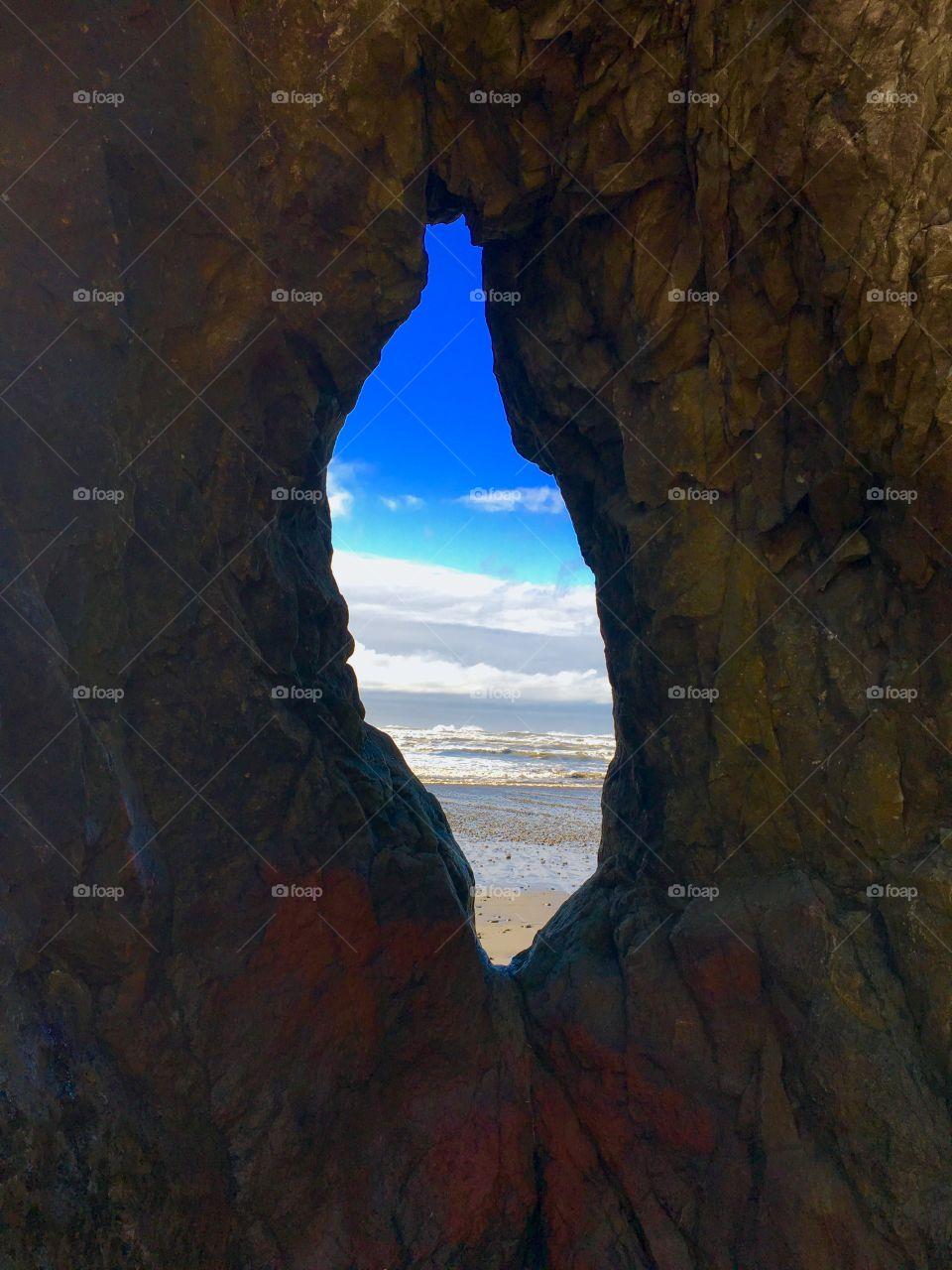 Scenic sea through cave
