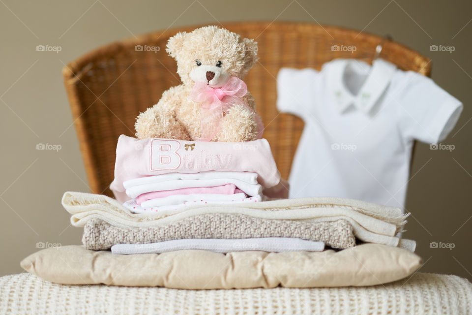 Stack of cloth with soft toy