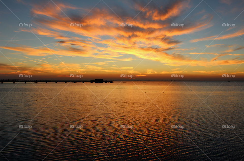 Scenic view of a  sea against dramatic sky