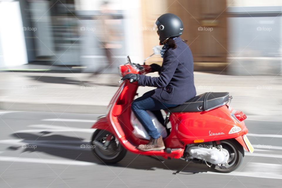 Woman on scooter.