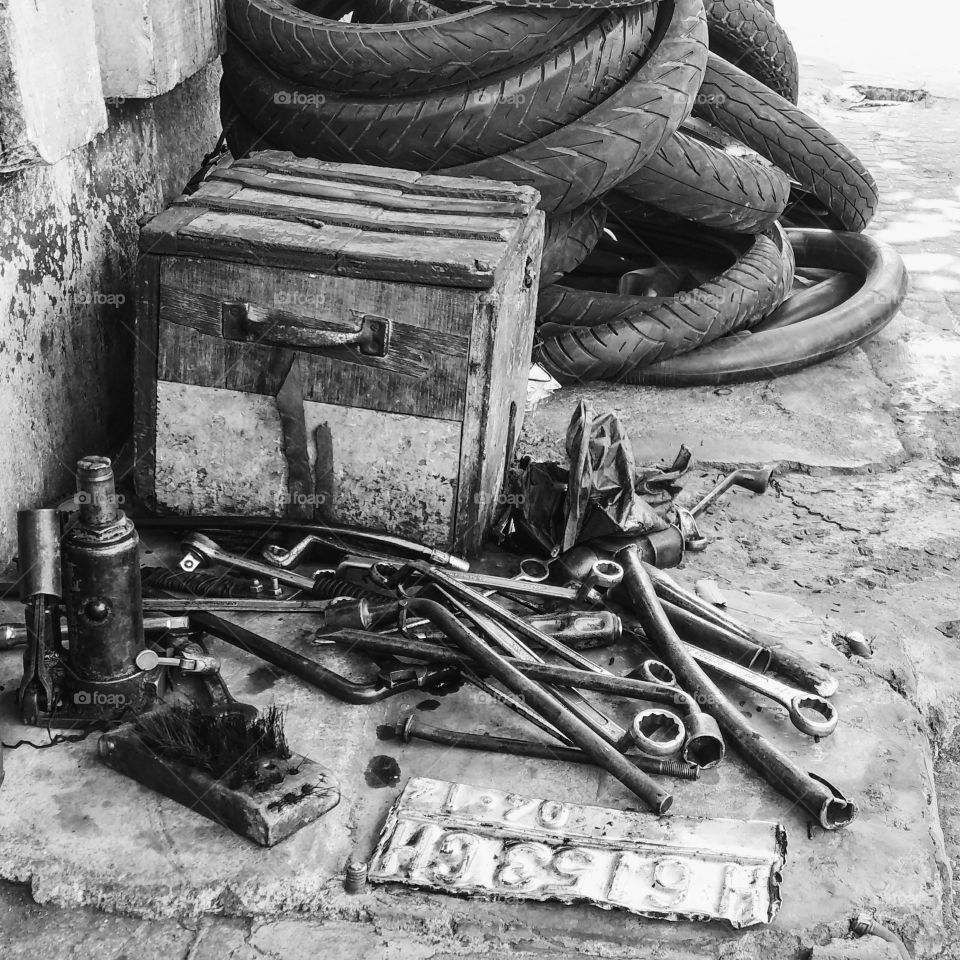 Greasy. A street repairman workshop when you get a flat tires