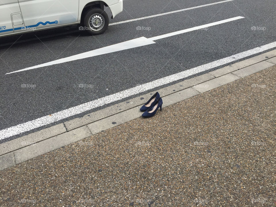 A lonely pair of high heels standing on the street in japan