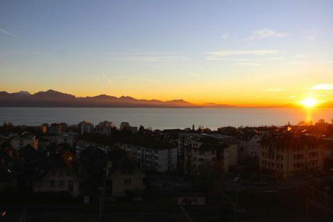 Sunset in Lausanne . Sunset of Lake Geneva overlooking Lausanne, Switzerland