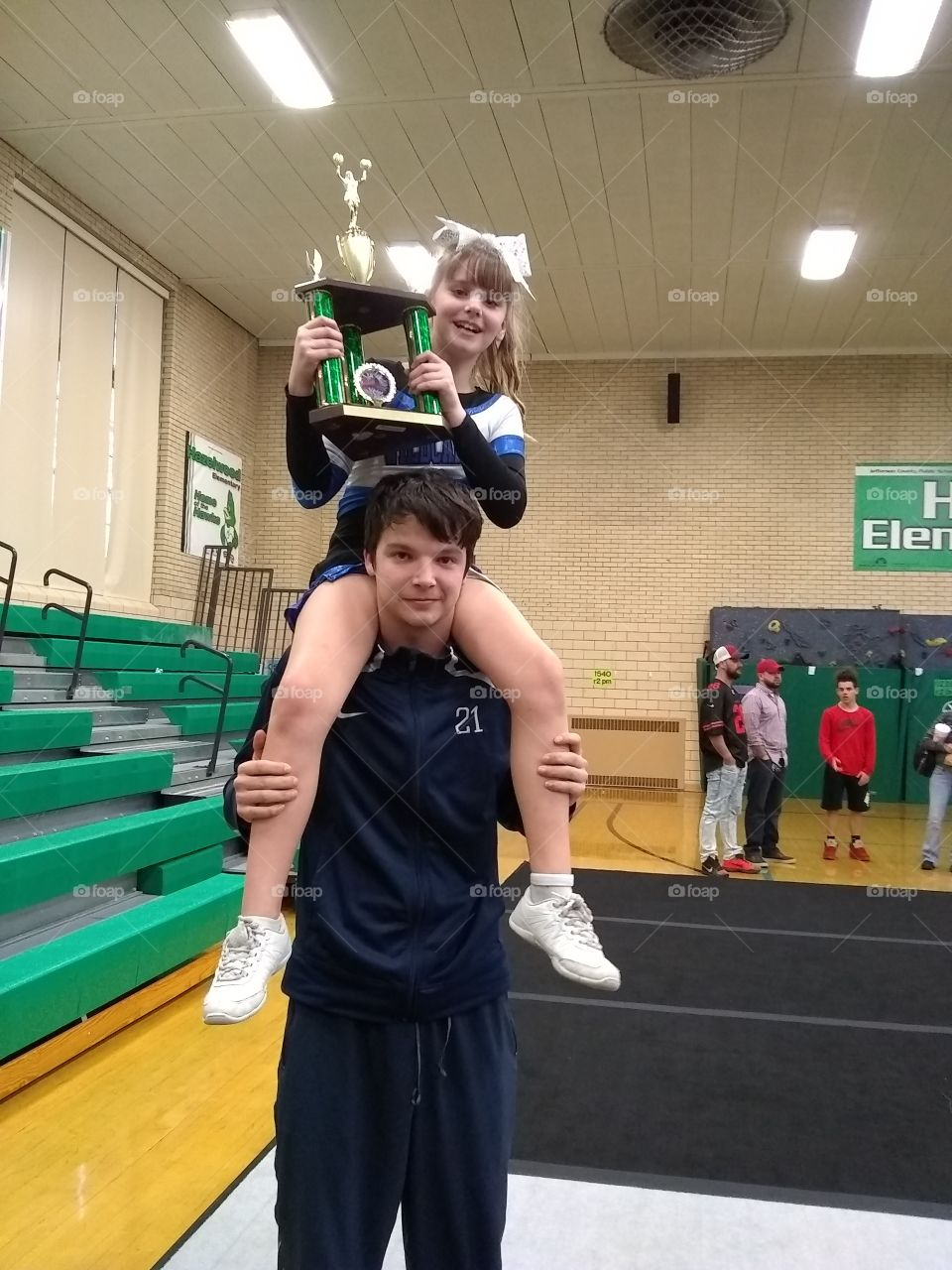 big bro proud of lil sis for another cheer 1st place