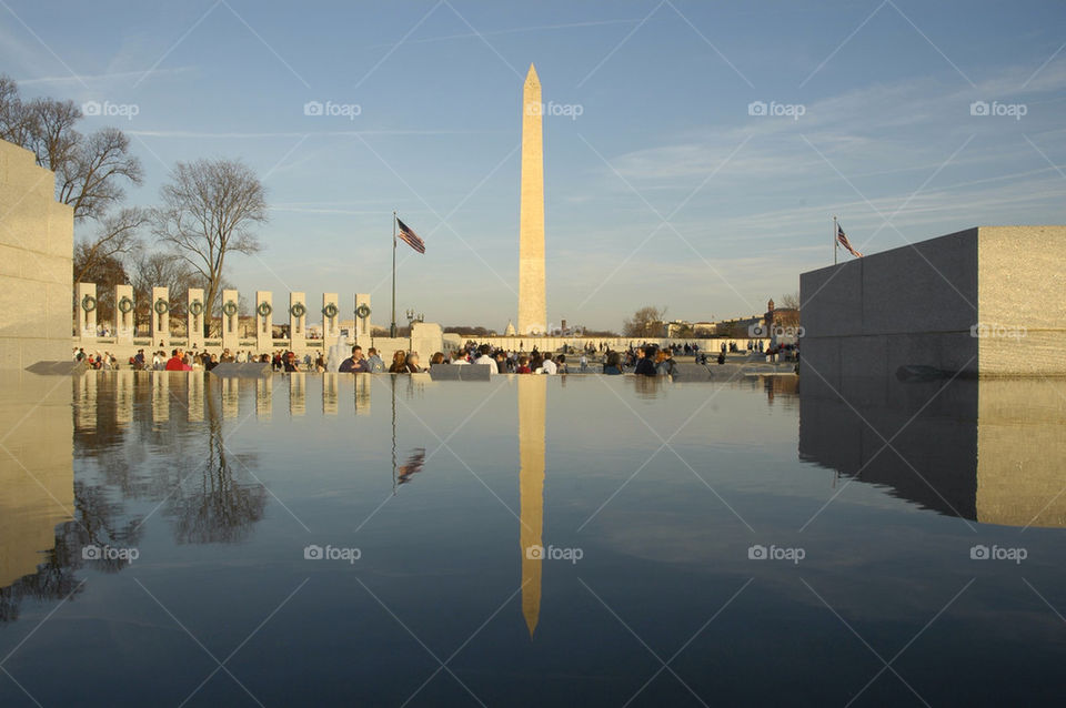 The Washington Monument reflected in a pool at the World War II