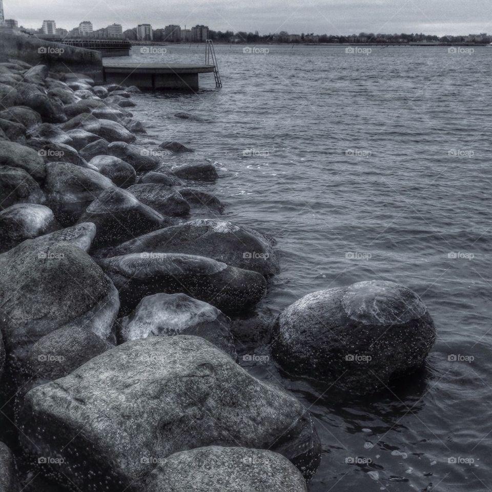 Pile of stones at lake