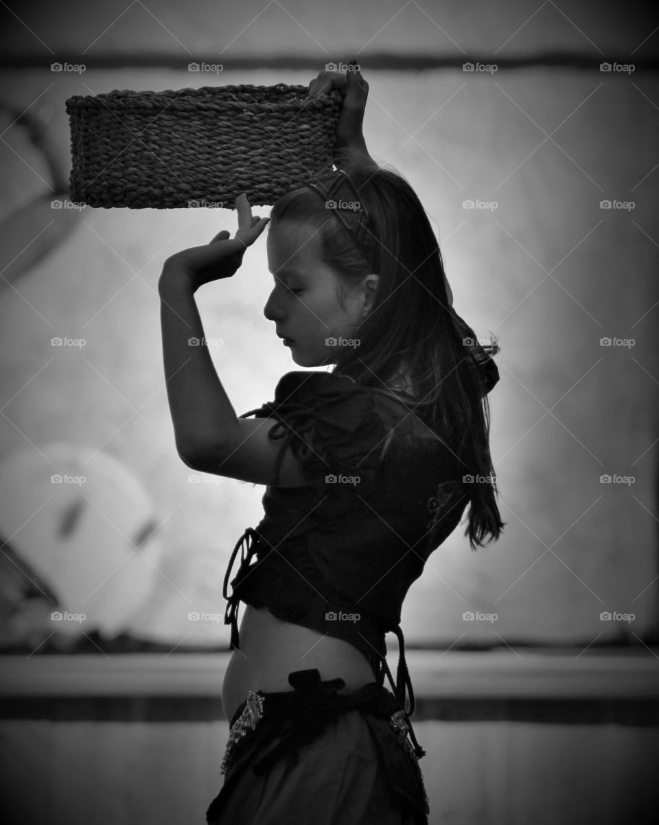 Girl carrying wicker basket