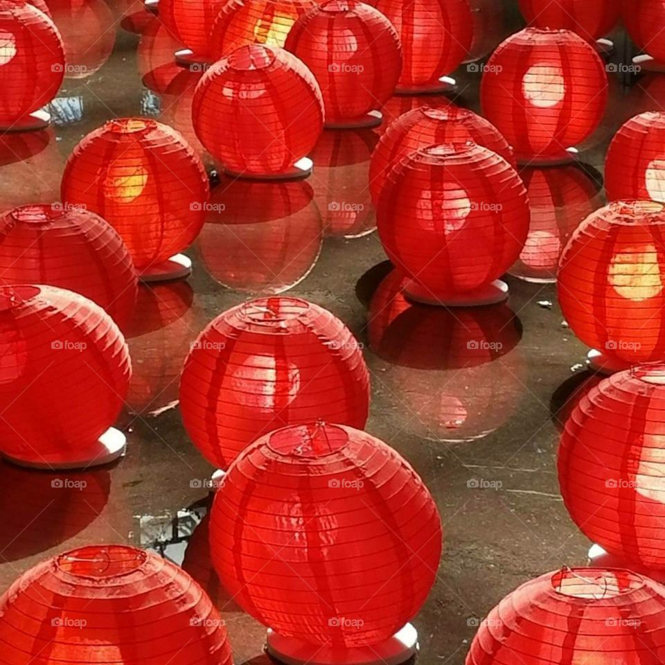 red Chinese lanterns gliding across water