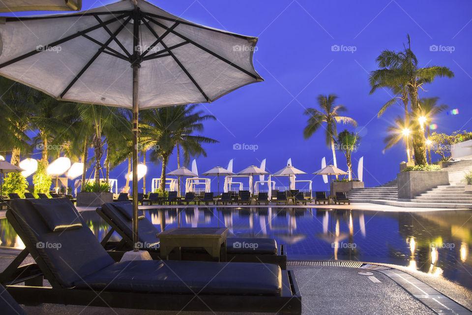 Hotel resort pool by night