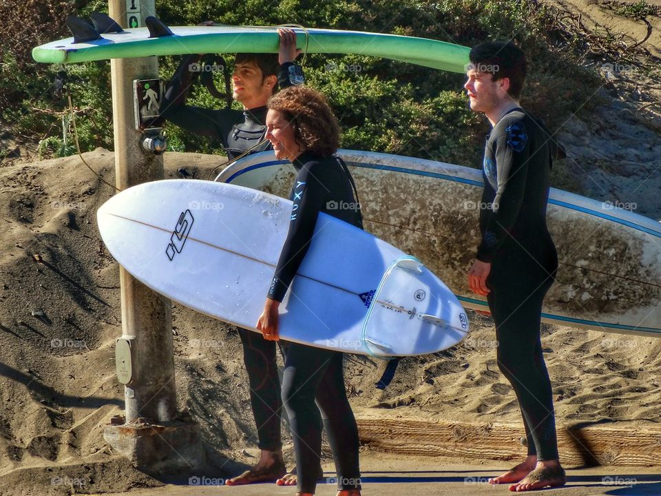 Three California Surfers. Surfers On Their Way To The Beach