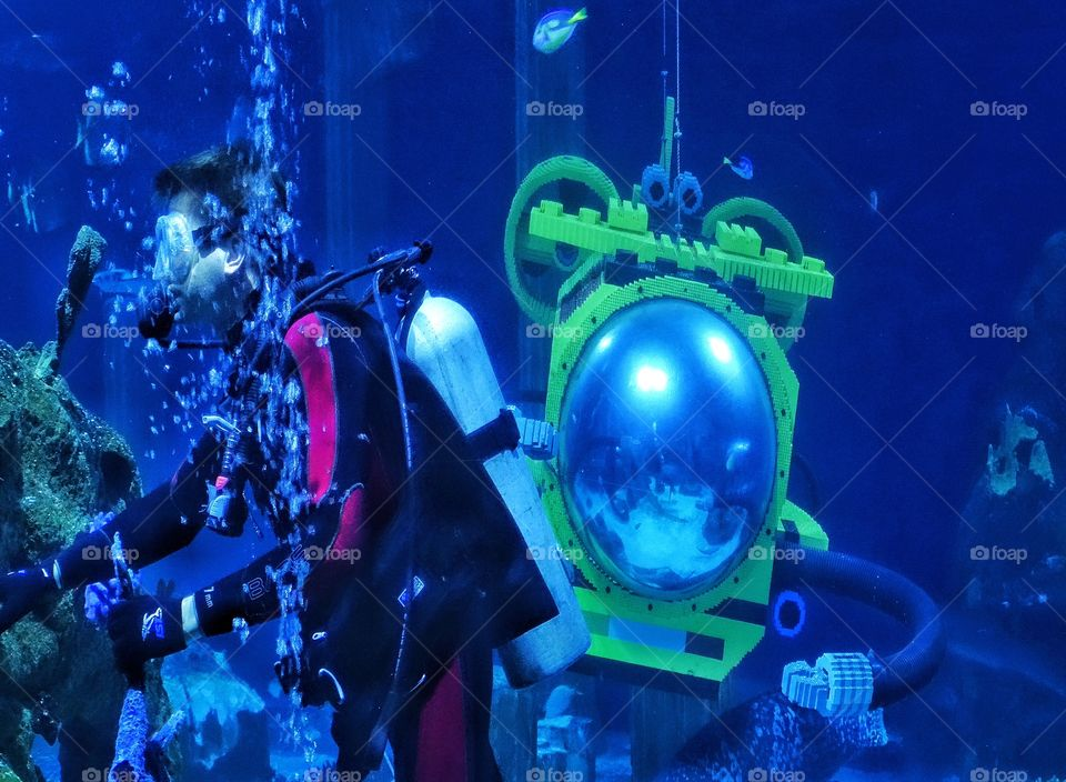Scuba Adventure. Underwater Explorer With A Yellow Submarine