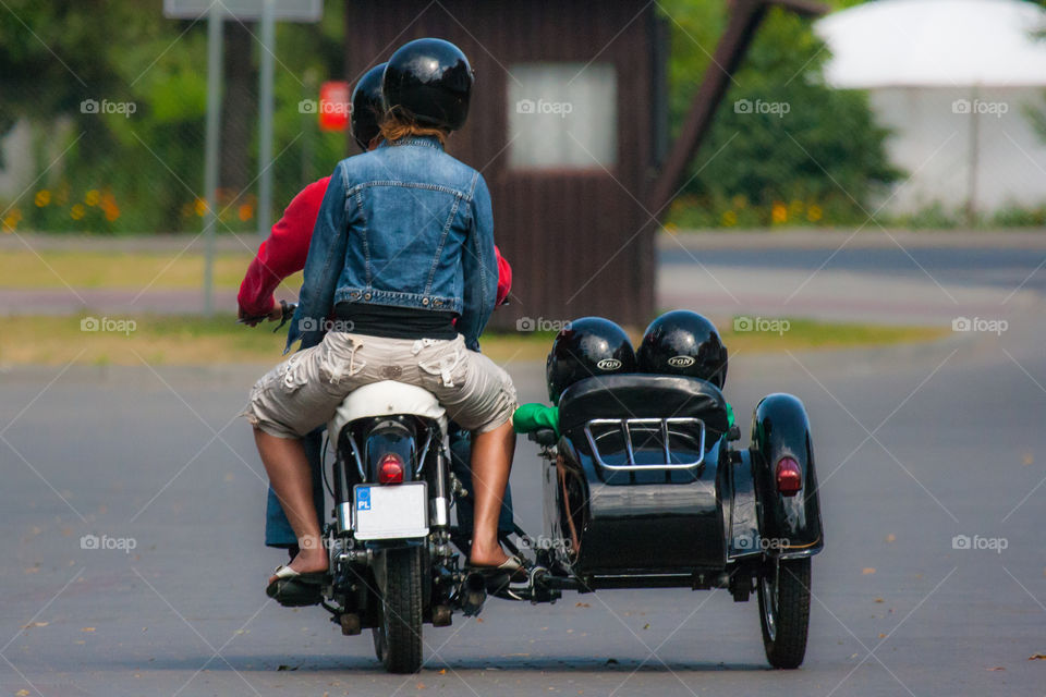 Family trip on motorcycle with sidecar