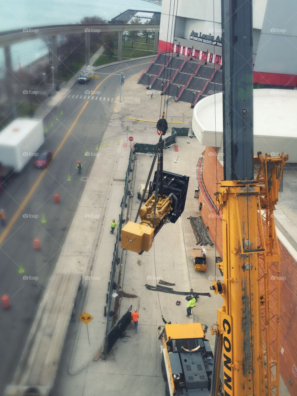 Construction site in Detroit! Moving a generator onto the roof of a building.